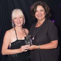 Jan Capper and Celestine Rowland receiving the Star School Association Award on behalf of IALC